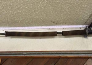 Broken garage door torsion spring Spokane