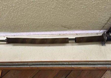 Broken garage door torsion spring Spokane