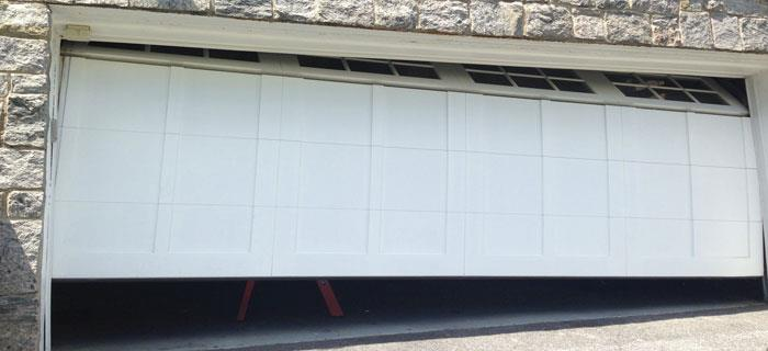Garage door off track repair Spokane